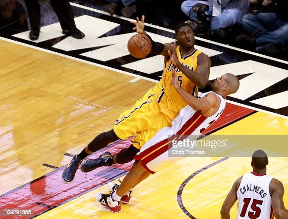 Roy Hibbert of the Indiana Pacers drives to the basket against Shane Battier of the Miami Heat in the first half during Game One of the Eastern...