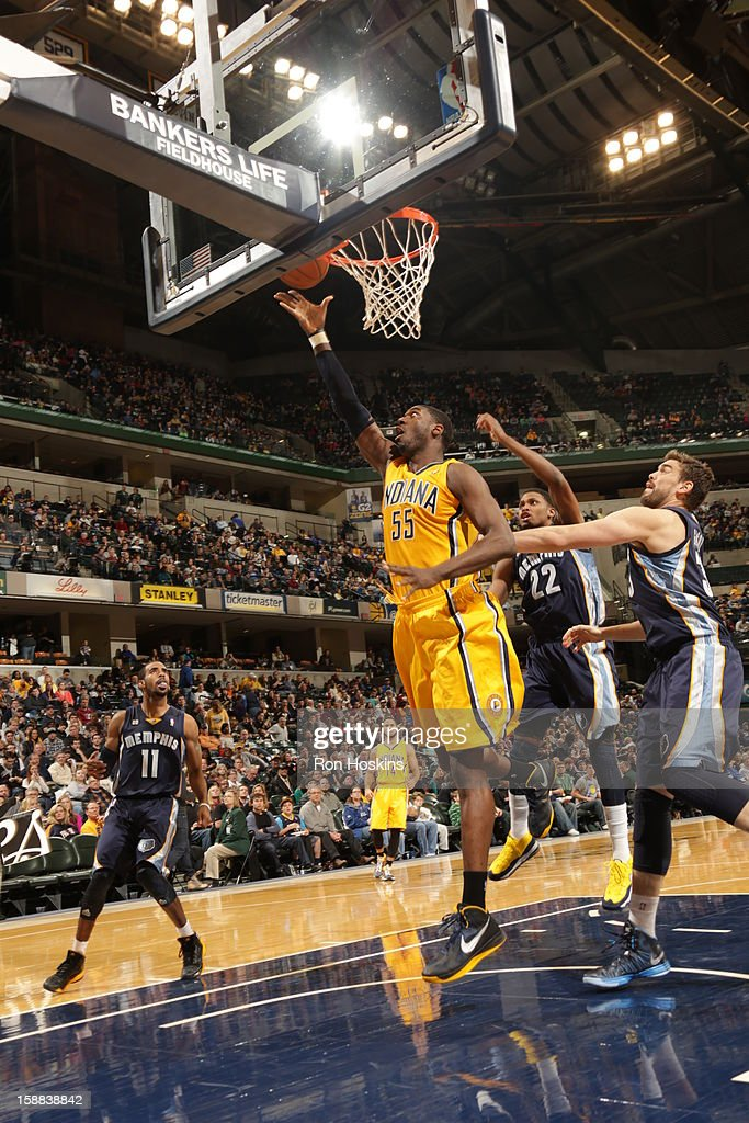 Roy Hibbert #55 of the Indiana Pacers drives to the basket against the Memphis Grizzlies on December 31, 2012 at Bankers Life Fieldhouse in Indianapolis, Indiana.