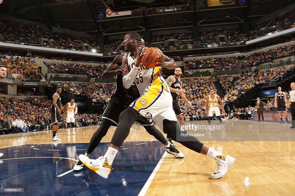 Roy Hibbert #55 of the Indiana Pacers drives to the basket against the Brooklyn Nets at Bankers Life Fieldhouse on December 28, 2013 in Indianapolis, Indiana.
