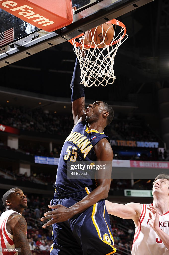 Roy Hibbert #55 of the Indiana Pacers dunks against Omer Asik #3 of the Houston Rockets on March 27, 2013 at the Toyota Center in Houston, Texas.