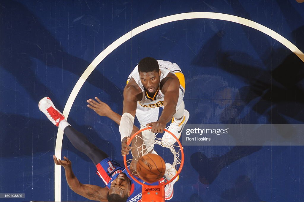 <a gi-track='captionPersonalityLinkClicked' href=/galleries/search?phrase=Roy+Hibbert&family=editorial&specificpeople=725128 ng-click='$event.stopPropagation()'>Roy Hibbert</a> #55 of the Indiana Pacers dunks against <a gi-track='captionPersonalityLinkClicked' href=/galleries/search?phrase=Rodney+Stuckey&family=editorial&specificpeople=4375687 ng-click='$event.stopPropagation()'>Rodney Stuckey</a> #3 of the Detroit Pistons on January 30, 2013 at Bankers Life Fieldhouse in Indianapolis, Indiana.