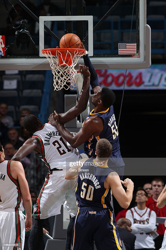 Roy Hibbert #55 of the Indiana Pacers dunks against Samuel Dalembert #21 of the Milwaukee Bucks during the NBA game on November 14, 2012 at the BMO Harris Bradley Center in Milwaukee, Wisconsin.