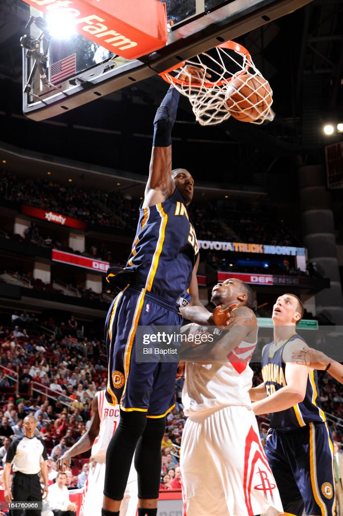 Roy Hibbert #55 of the Indiana Pacers dunks against Thomas Robinson #41 of the Houston Rockets on March 27, 2013 at the Toyota Center in Houston, Texas.
