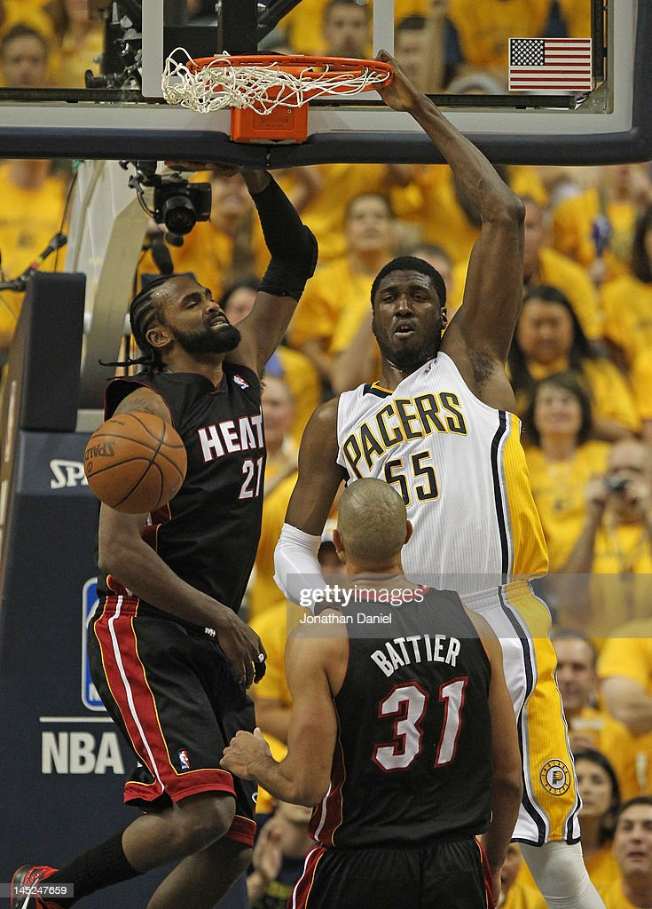 Roy Hibbert #55 of the Indiana Pacers dunks over Ronny Turiaf #21 and Shane Battier #31 of the Miami Heat in Game Six of the Eastern Conference Semifinals in the 2012 NBA Playoffs at Bankers Life Fieldhouse on May 24, 2012 in Indianapolis, Indiana.