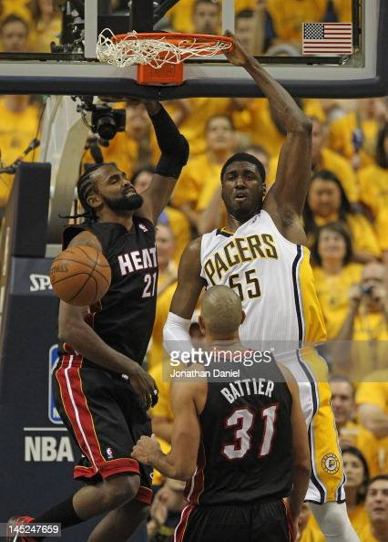 Roy Hibbert of the Indiana Pacers dunks over Ronny Turiaf and Shane Battier of the Miami Heat in Game Six of the Eastern Conference Semifinals in the...