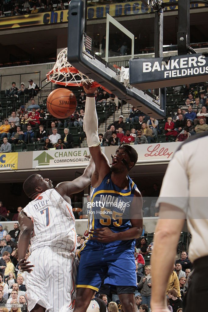 Roy Hibbert #55 of the Indiana Pacers dunks the ball against DeSagana Diop #7 of the Charlotte Bobcats on February 19, 2012 at Bankers Life Fieldhouse in Indianapolis, Indiana.