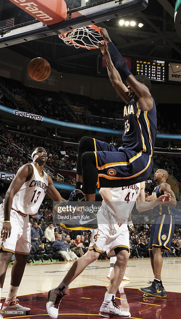 Roy Hibbert #55 of the Indiana Pacers dunks the ball against Tristan Thompson #13 and Tyler Zeller #40 of the Cleveland Cavaliers at The Quicken Loans Arena on December 21, 2012 in Cleveland, Ohio.