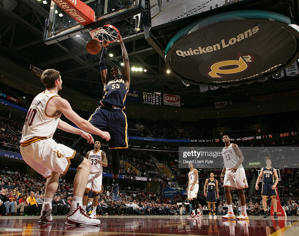 Roy Hibbert #55 of the Indiana Pacers dunks the ball against Tyler Zeller #40 of the Cleveland Cavaliers at The Quicken Loans Arena on March 18, 2013 in Cleveland, Ohio.