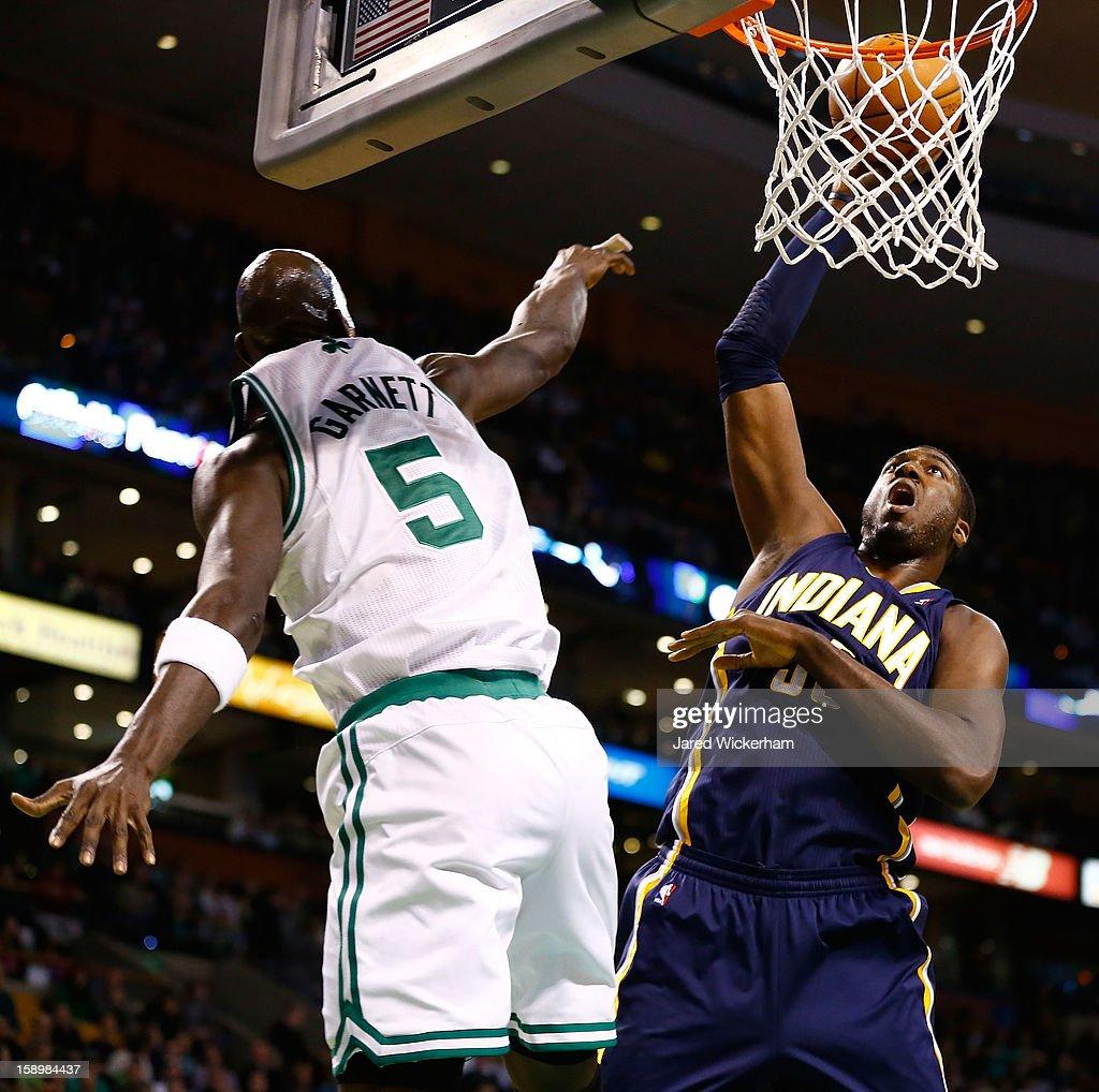 Roy Hibbert #55 of the Indiana Pacers dunks the ball over Kevin Garnett #5 of the Boston Celtics during the game on January 4, 2013 at TD Garden in Boston, Massachusetts.