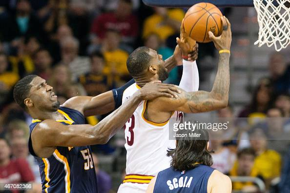 Roy Hibbert of the Indiana Pacers fouls LeBron James of the Cleveland Cavaliers during the first half at Quicken Loans Arena on March 20 2015 in...