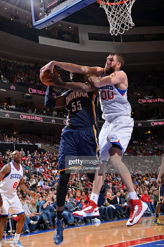 Roy Hibbert #55 of the Indiana Pacers gets his shot blocked by Spencer Hawes #00 of the Philadelphia 76ers at the Wells Fargo Center on March 16, 2013 in Philadelphia, Pennsylvania.