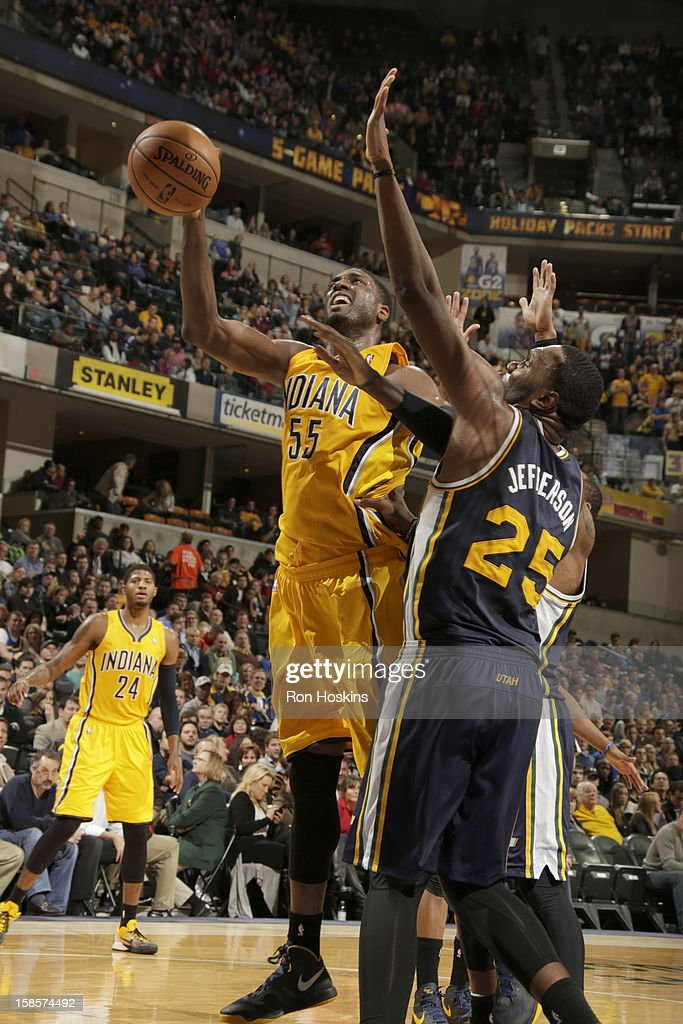 Roy Hibbert #55 of the Indiana Pacers goes to the basket against Al Jefferson #25 of the Utah Jazz during the game between the Indiana Pacers and the Utah Jazz on December 19, 2012 at Bankers Life Fieldhouse in Indianapolis, Indiana.
