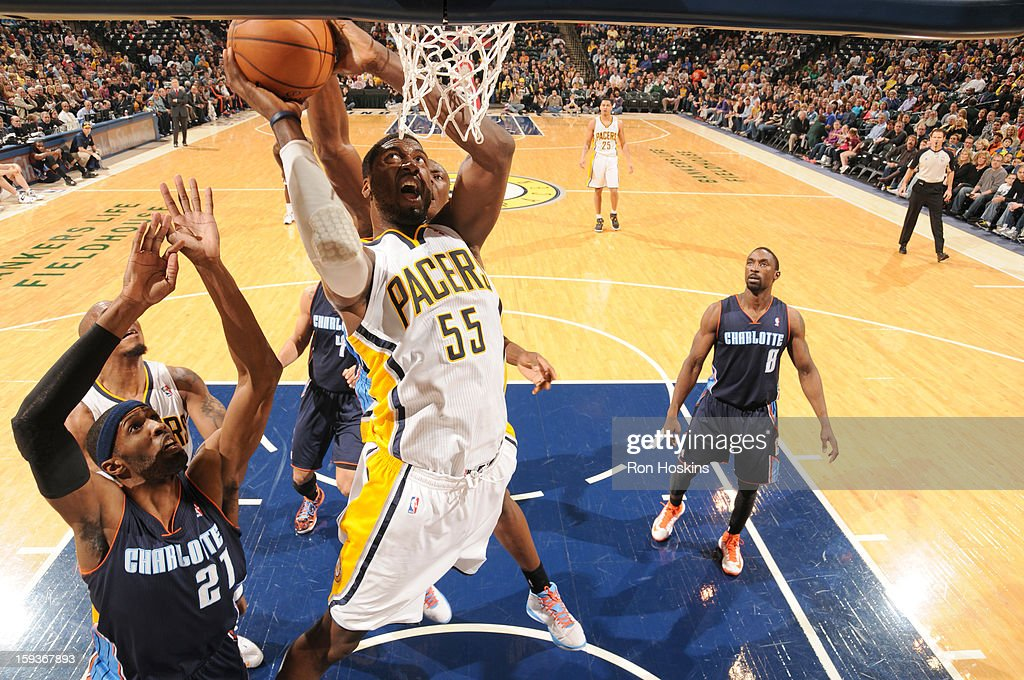 Roy Hibbert #55 of the Indiana Pacers goes to the basket against Hakim Warrick #21 of the Charlotte Bobcats during the game between the Indiana Pacers and the Charlotte Bobcats on January 12, 2013 at Bankers Life Fieldhouse in Indianapolis, Indiana.