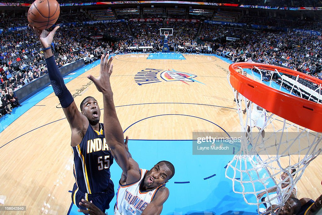 Roy Hibbert #55 of the Indiana Pacers goes to the basket against Serge Ibaka #9 of the Oklahoma City Thunder during the game between the Oklahoma City Thunder and the Indiana Pacers on December 9, 2012 at the Chesapeake Energy Arena in Oklahoma City, Oklahoma.