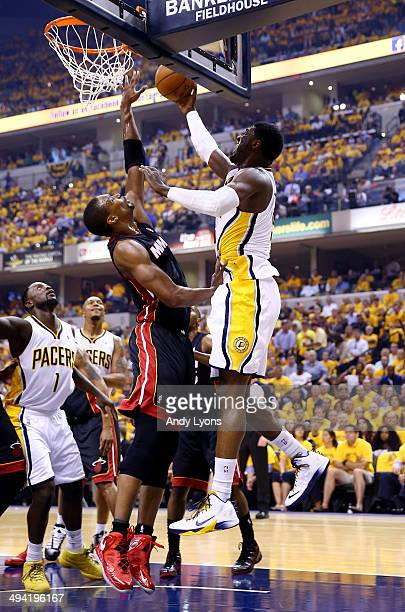 Roy Hibbert of the Indiana Pacers goes to the basket as Chris Bosh of the Miami Heat defends during Game Five of the Eastern Conference Finals of the...