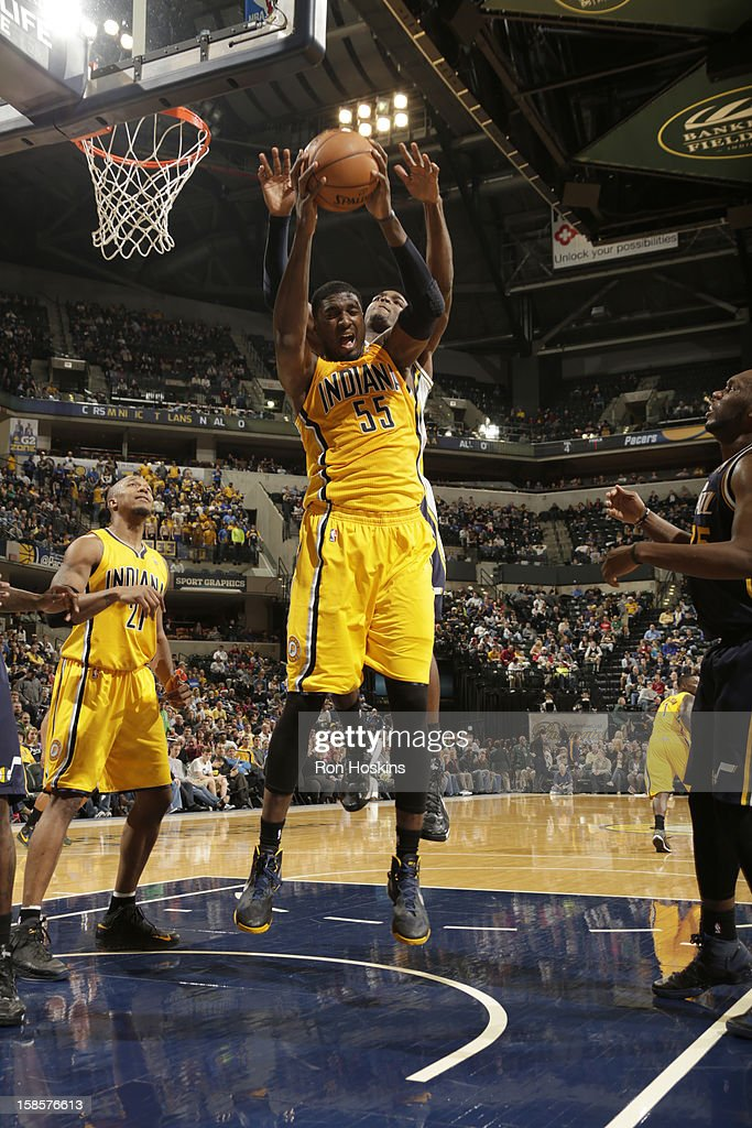 Roy Hibbert #55 of the Indiana Pacers goes to the basket under pressure during the game between the Indiana Pacers and the Utah Jazz on December 19, 2012 at Bankers Life Fieldhouse in Indianapolis, Indiana.