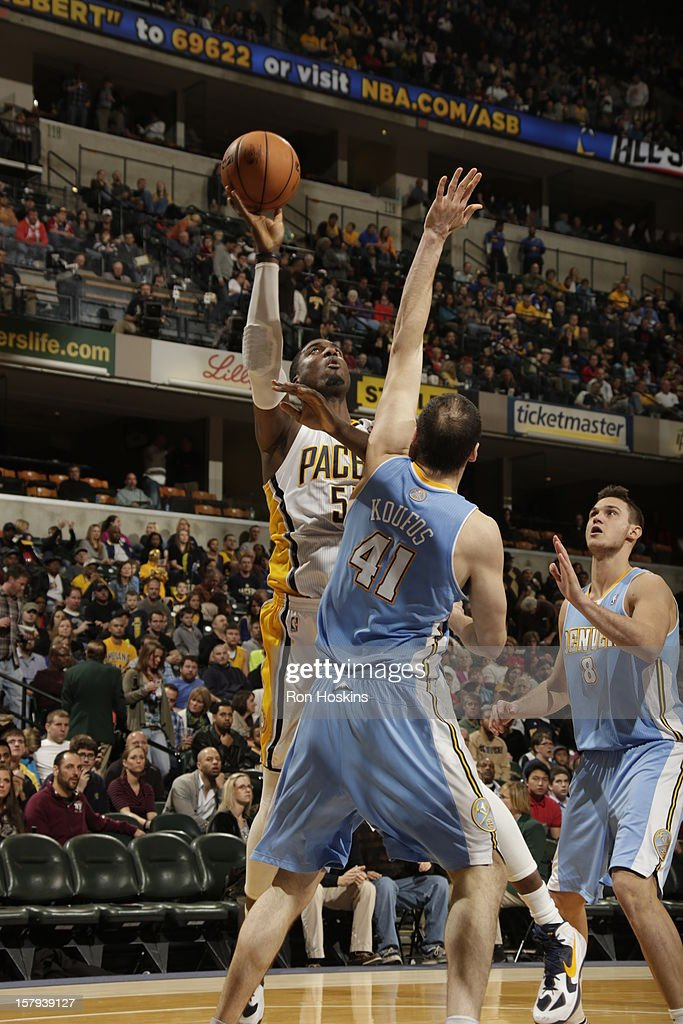 Roy Hibbert #55 of the Indiana Pacers goes up for a shot against Kosta Koufos #41 of the Denver Nuggets on December 7, 2012 at Bankers Life Fieldhouse in Indianapolis, Indiana.