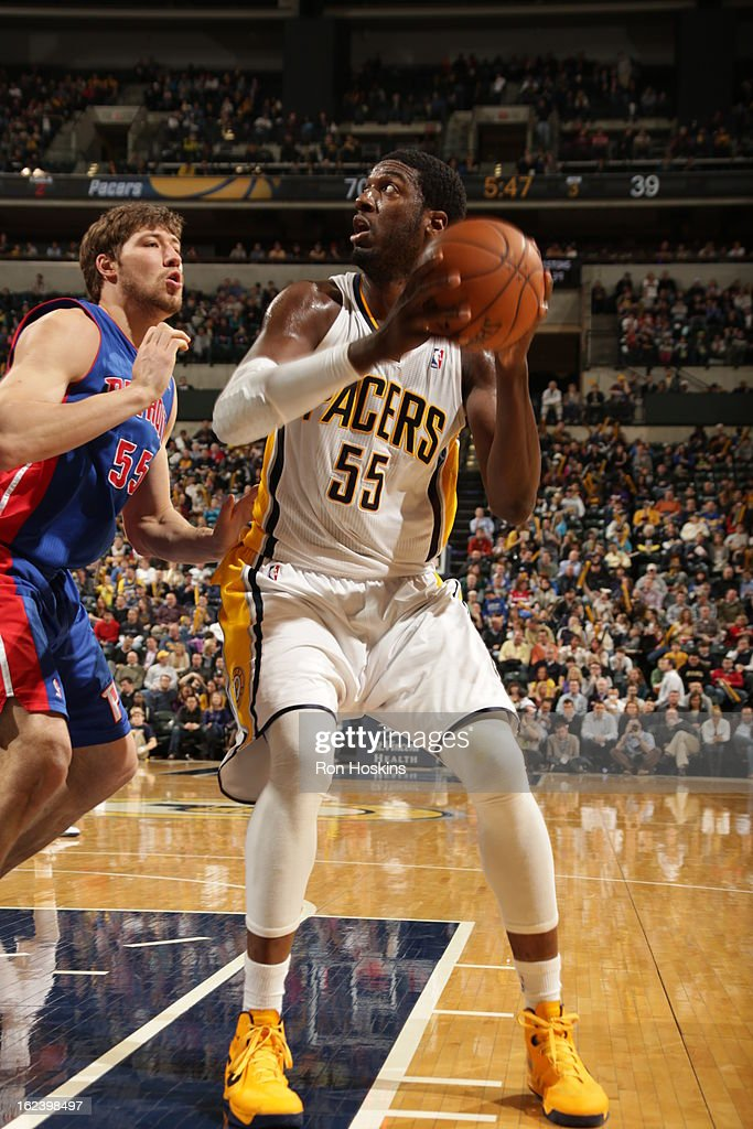 Roy Hibbert #55 of the Indiana Pacers goes up for the shot against Viacheslav Kravtsov #55 of the Detroit Pistons on February 22, 2013 at Bankers Life Fieldhouse in Indianapolis, Indiana.
