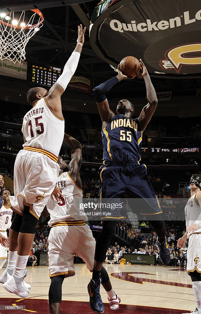Roy Hibbert #55 of the Indiana Pacers goes up for the shot against Marreese Speights #15 of the Cleveland Cavaliers at The Quicken Loans Arena on March 18, 2013 in Cleveland, Ohio.