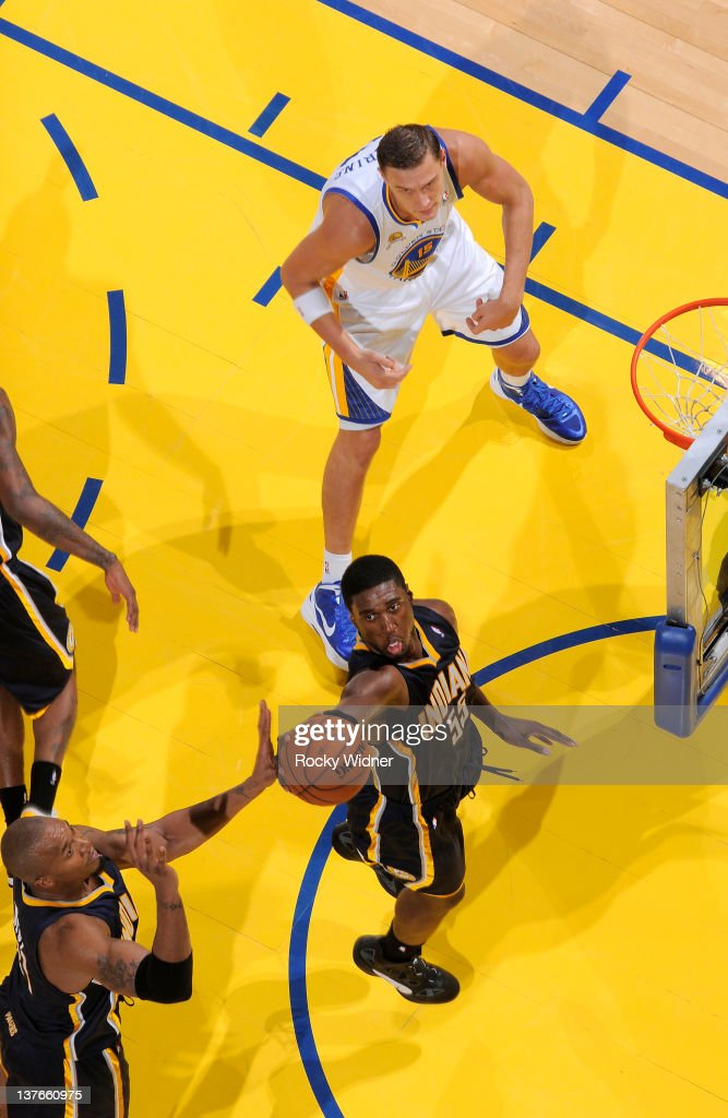 <a gi-track='captionPersonalityLinkClicked' href=/galleries/search?phrase=Roy+Hibbert&family=editorial&specificpeople=725128 ng-click='$event.stopPropagation()'>Roy Hibbert</a> #55 of the Indiana Pacers grabs a rebound against <a gi-track='captionPersonalityLinkClicked' href=/galleries/search?phrase=Andris+Biedrins&family=editorial&specificpeople=204473 ng-click='$event.stopPropagation()'>Andris Biedrins</a> #15 of the Golden State Warriors on January 20, 2012 at Oracle Arena in Oakland, California.