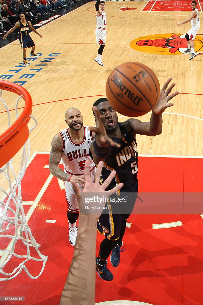 Roy Hibbert #55 of the Indiana Pacers grabs a rebound against the Chicago Bulls on March 23, 2013 at the United Center in Chicago, Illinois.
