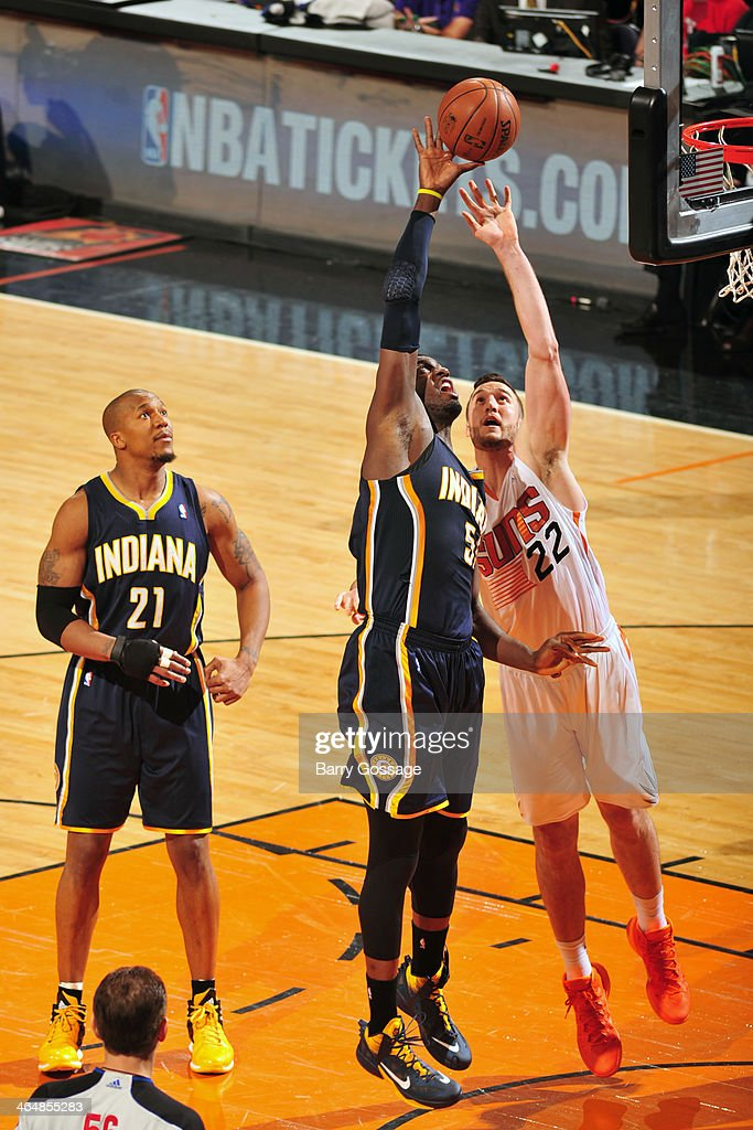<a gi-track='captionPersonalityLinkClicked' href=/galleries/search?phrase=Roy+Hibbert&family=editorial&specificpeople=725128 ng-click='$event.stopPropagation()'>Roy Hibbert</a> #55 of the Indiana Pacers grabs the rebound against <a gi-track='captionPersonalityLinkClicked' href=/galleries/search?phrase=Miles+Plumlee&family=editorial&specificpeople=5645212 ng-click='$event.stopPropagation()'>Miles Plumlee</a> #22 of the Phoenix Suns on January 22, 2014 at U.S. Airways Center in Phoenix, Arizona.