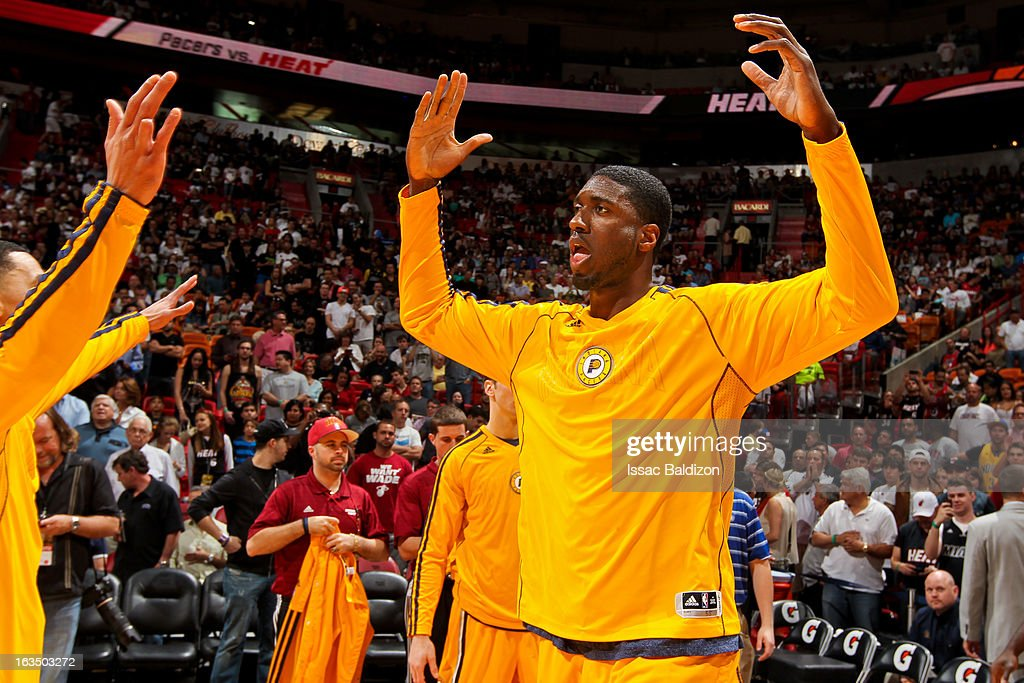 <a gi-track='captionPersonalityLinkClicked' href=/galleries/search?phrase=Roy+Hibbert&family=editorial&specificpeople=725128 ng-click='$event.stopPropagation()'>Roy Hibbert</a> #55 of the Indiana Pacers greets teammates before playing against the Miami Heat on March 10, 2013 at American Airlines Arena in Miami, Florida.