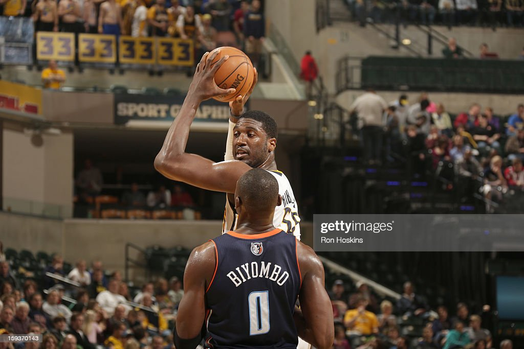 Roy Hibbert #55 of the Indiana Pacers handles the ball against Bismack Biyombo #0 of the Charlotte Bobcats during the game between the Indiana Pacers and the Charlotte Bobcats on January 12, 2013 at Bankers Life Fieldhouse in Indianapolis, Indiana.