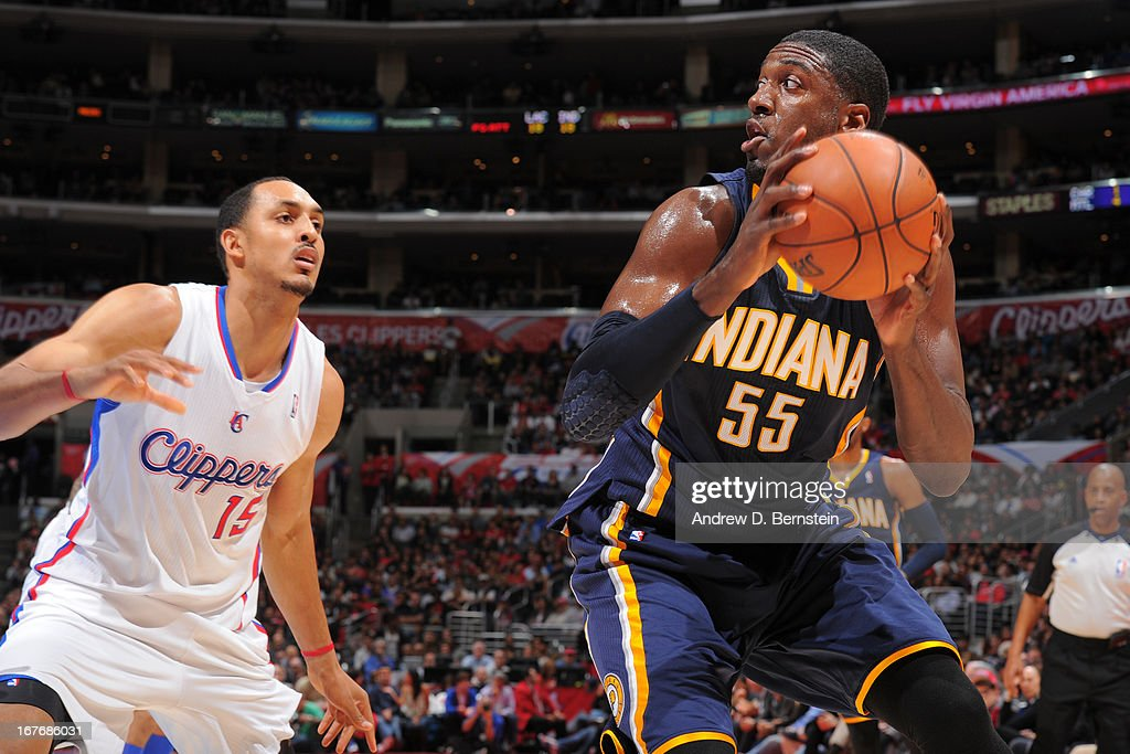 <a gi-track='captionPersonalityLinkClicked' href=/galleries/search?phrase=Roy+Hibbert&family=editorial&specificpeople=725128 ng-click='$event.stopPropagation()'>Roy Hibbert</a> #55 of the Indiana Pacers handles the ball against <a gi-track='captionPersonalityLinkClicked' href=/galleries/search?phrase=Ryan+Hollins&family=editorial&specificpeople=182556 ng-click='$event.stopPropagation()'>Ryan Hollins</a> #15 of the Los Angeles Clippers at Staples Center on April 1, 2013 in Los Angeles, California.