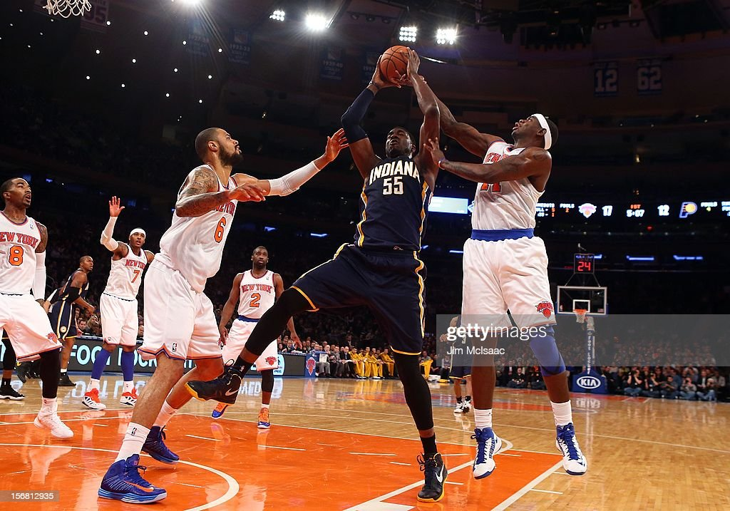 Roy Hibbert #55 of the Indiana Pacers in action against Tyson Chandler #6 and Ronnie Brewer #11 of the New York Knicks at Madison Square Garden on November 18, 2012 in New York City. The Knicks defeated the Pacers 88-76.