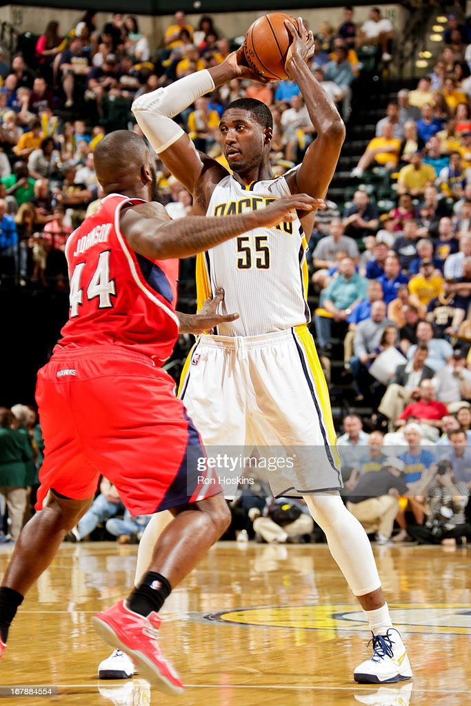 Roy Hibbert #55 of the Indiana Pacers looks to pass the ball against Ivan Johnson #44 of the Atlanta Hawks in Game Five of the Eastern Conference Quarterfinals during the 2013 NBA Playoffs on May 1, 2013 at Bankers Life Fieldhouse in Indianapolis, Indiana.
