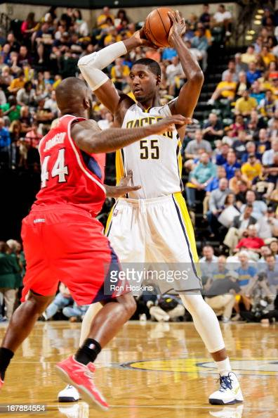 Roy Hibbert of the Indiana Pacers looks to pass the ball against Ivan Johnson of the Atlanta Hawks in Game Five of the Eastern Conference...