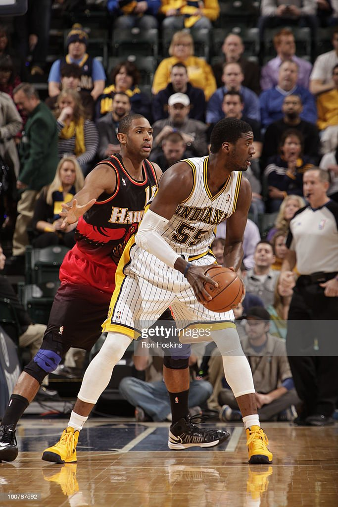 <a gi-track='captionPersonalityLinkClicked' href=/galleries/search?phrase=Roy+Hibbert&family=editorial&specificpeople=725128 ng-click='$event.stopPropagation()'>Roy Hibbert</a> #55 of the Indiana Pacers looks to pass the ball against the Atlanta Hawks on February 5, 2013 at Bankers Life Fieldhouse in Indianapolis, Indiana.