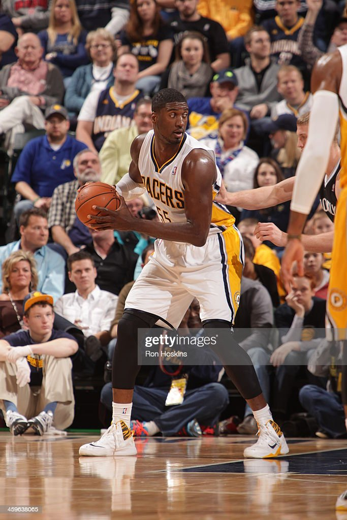 Roy Hibbert #55 of the Indiana Pacers looks to pass the ball against the Brooklyn Nets at Bankers Life Fieldhouse on December 28, 2013 in Indianapolis, Indiana.