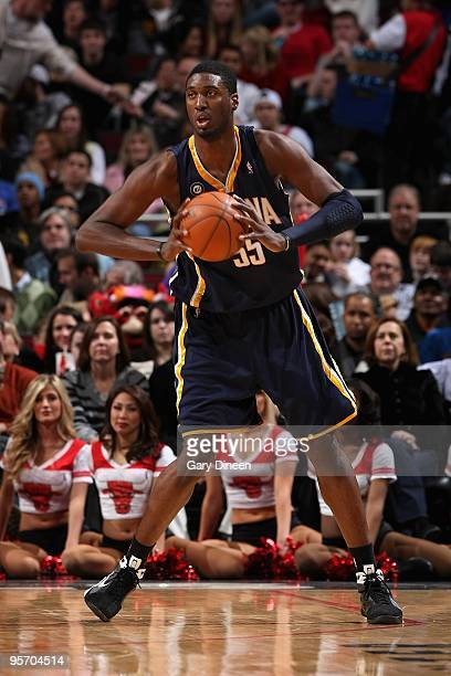 Roy Hibbert of the Indiana Pacers looks to pass the ball against the Chicago Bulls during the game on December 29 2009 at the United Center in...