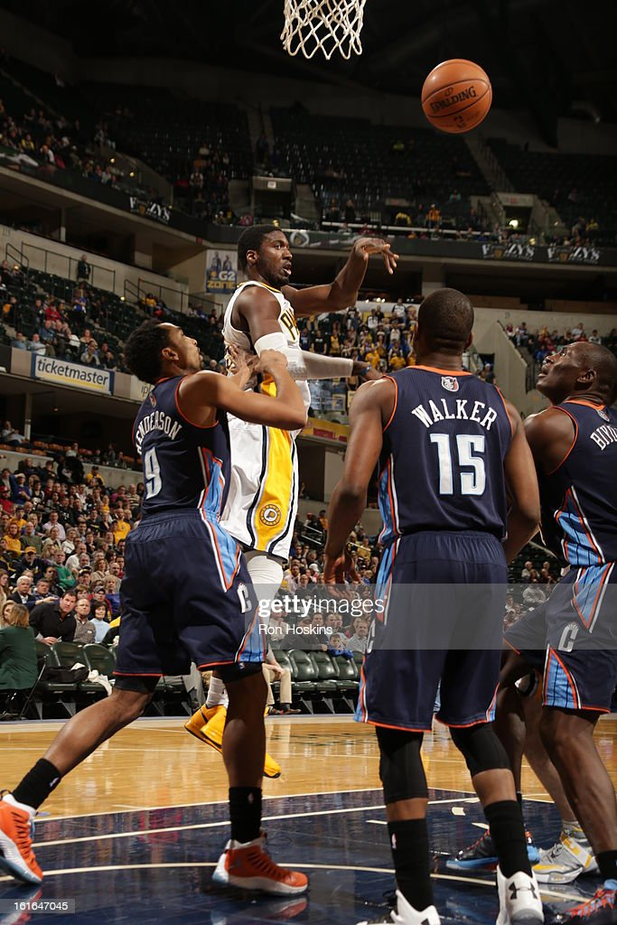 Roy Hibbert #55 of the Indiana Pacers passes the ball against Gerald Henderson #9, Kemba Walker #15, and Bismack Biyombo #0 of the Charlotte Bobcats on February 13, 2013 at Bankers Life Fieldhouse in Indianapolis, Indiana.