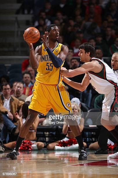 Roy Hibbert of the Indiana Pacers posts up against Andrew Bogut of the Milwaukee Bucks on March 14 2010 at the Bradley Center in Milwaukee Wisconsin...