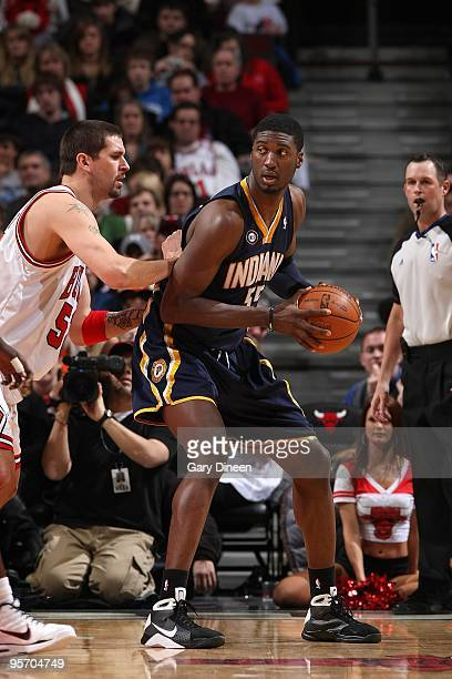 Roy Hibbert of the Indiana Pacers posts up against Brad Miller of the Chicago Bulls during the game on December 29 2009 at the United Center in...