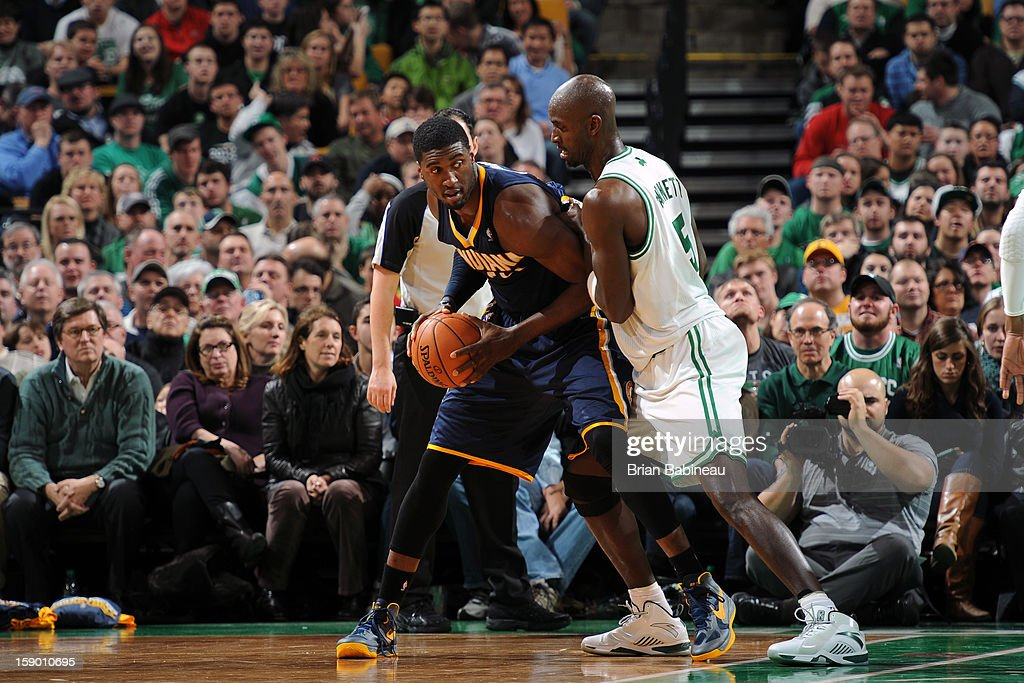 Roy Hibbert #55 of the Indiana Pacers posts up against Kevin Garnett #5 of the Boston Celtics on January 4, 2013 at the TD Garden in Boston, Massachusetts.