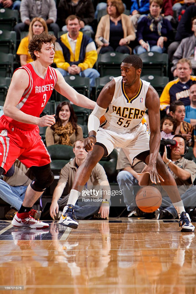 Roy Hibbert #55 of the Indiana Pacers posts-up against Omer Asik #3 of the Houston Rockets on January 18, 2013 at Bankers Life Fieldhouse in Indianapolis, Indiana.