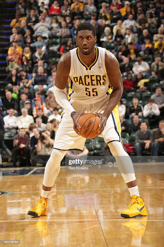 Roy Hibbert #55 of the Indiana Pacers protects the ball during the game between the Indiana Pacers and the New York Knicks on February 20, 2013 at Bankers Life Fieldhouse in Indianapolis, Indiana.