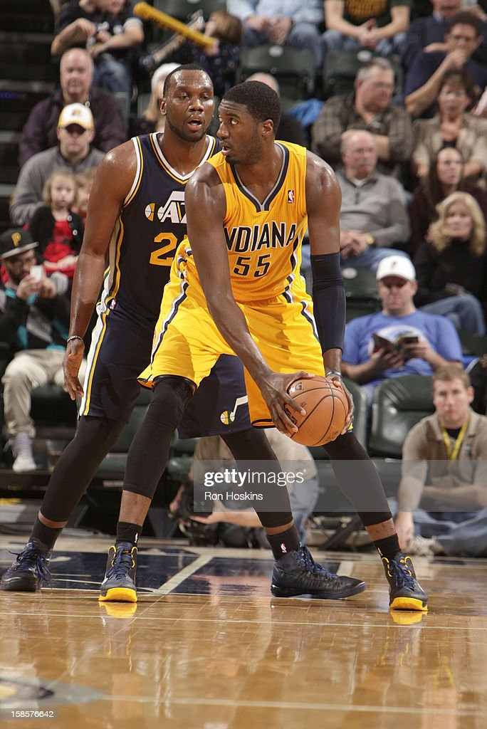 Roy Hibbert #55 of the Indiana Pacers protects the ball from Al Jefferson #25 of the Utah Jazz during the game between the Indiana Pacers and the Utah Jazz on December 19, 2012 at Bankers Life Fieldhouse in Indianapolis, Indiana.