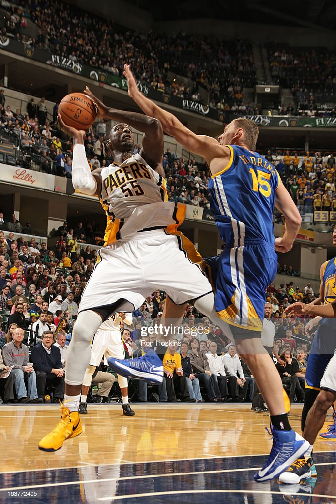 Roy Hibbert #55 of the Indiana Pacers puts up a shot against the Golden State Warriors on February 26, 2013 at Bankers Life Fieldhouse in Indianapolis, Indiana.