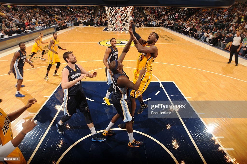 Roy Hibbert #55 of the Indiana Pacers puts up a shot over Zach Randolph #50 of the Memphis Grizzlies on December 31, 2012 at Bankers Life Fieldhouse in Indianapolis, Indiana.