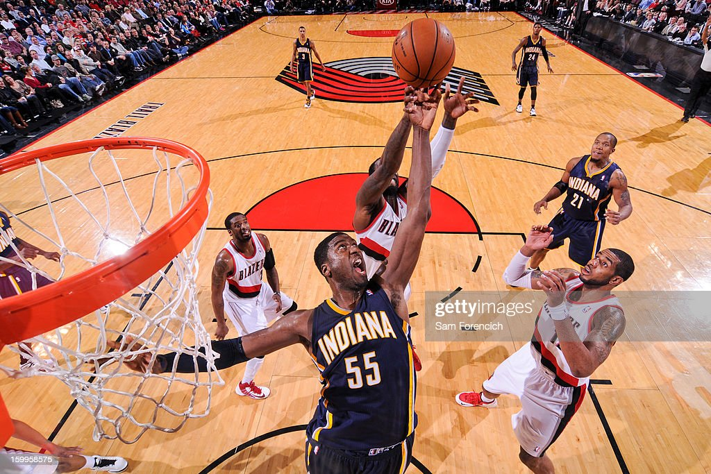 Roy Hibbert #55 of the Indiana Pacers reaches for a rebound against the Portland Trail Blazers on January 23, 2013 at the Rose Garden Arena in Portland, Oregon.
