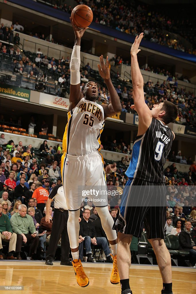<a gi-track='captionPersonalityLinkClicked' href=/galleries/search?phrase=Roy+Hibbert&family=editorial&specificpeople=725128 ng-click='$event.stopPropagation()'>Roy Hibbert</a> #55 of the Indiana Pacers shoots a hookshot against Nikola Vucevic #9 of the Orlando Magic on March 19, 2013 at Bankers Life Fieldhouse in Indianapolis, Indiana.