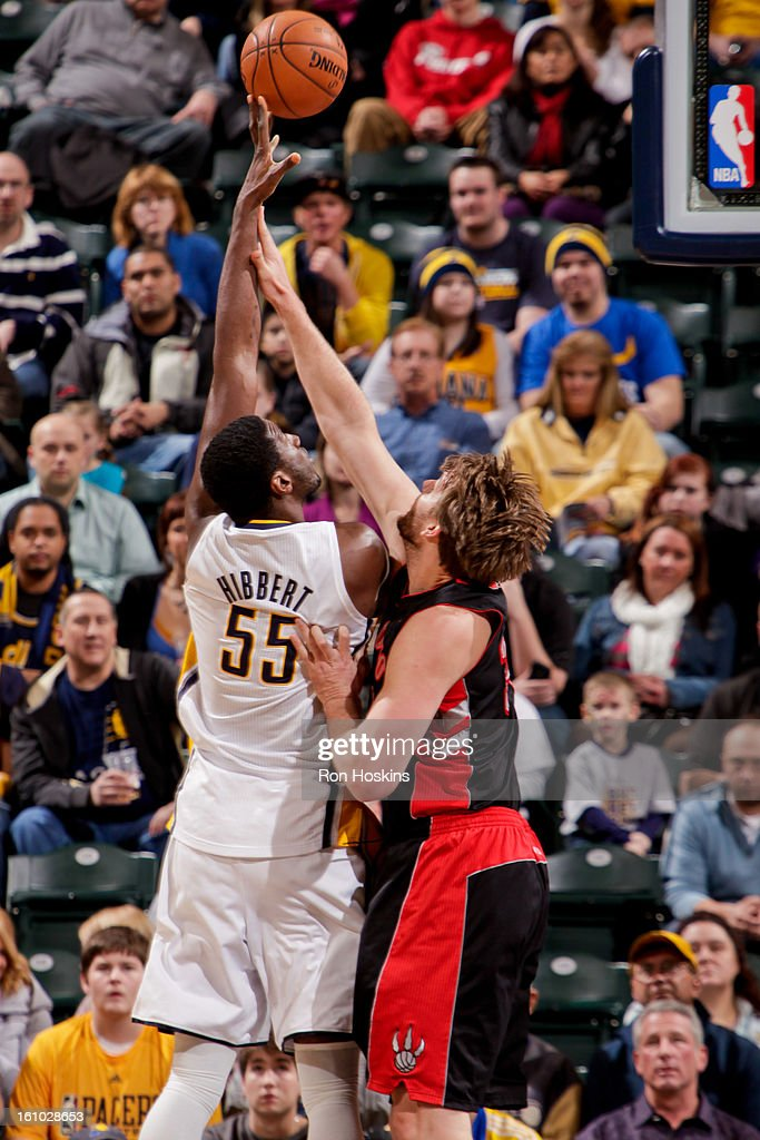Roy Hibbert #55 of the Indiana Pacers shoots against Aaron Gray #34 of the Toronto Raptors on February 8, 2013 at Bankers Life Fieldhouse in Indianapolis, Indiana.