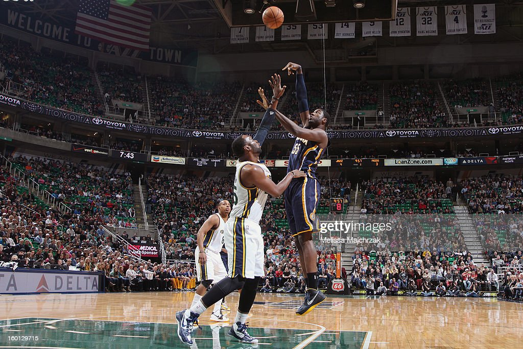 Roy Hibbert #55 of the Indiana Pacers shoots against Al Jefferson #25 of the Utah Jazz at Energy Solutions Arena on January 26, 2013 in Salt Lake City, Utah.