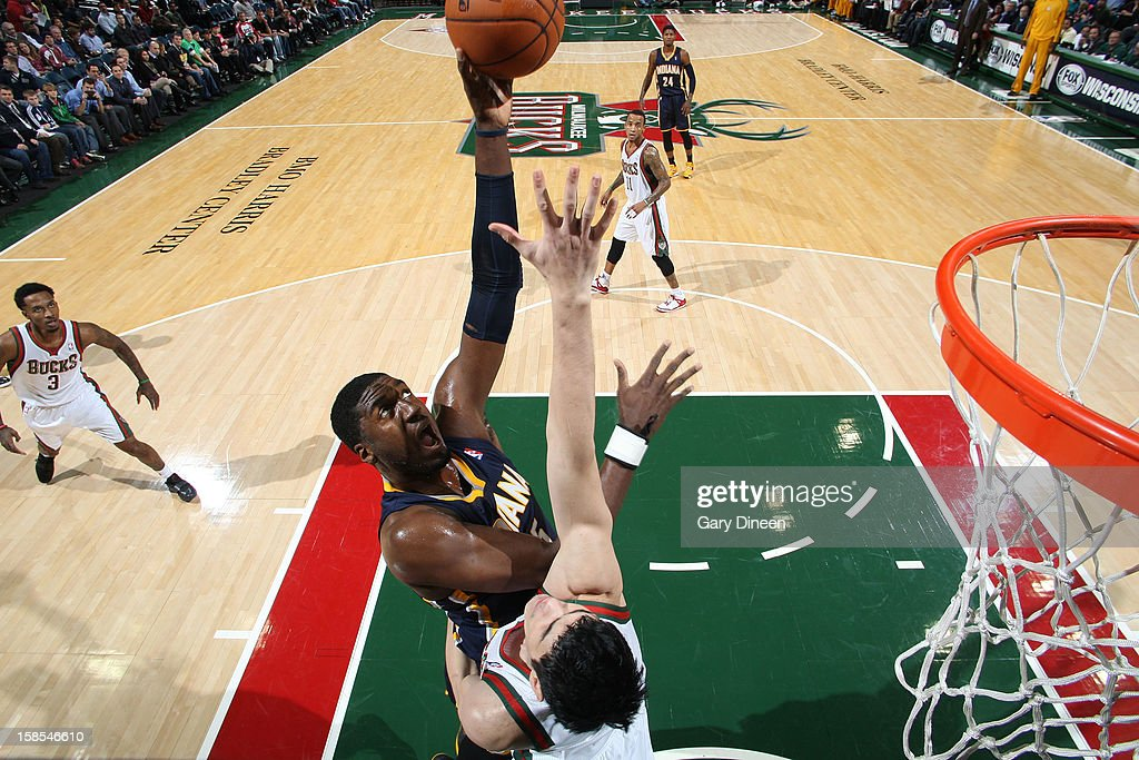<a gi-track='captionPersonalityLinkClicked' href=/galleries/search?phrase=Roy+Hibbert&family=editorial&specificpeople=725128 ng-click='$event.stopPropagation()'>Roy Hibbert</a> #55 of the Indiana Pacers shoots against <a gi-track='captionPersonalityLinkClicked' href=/galleries/search?phrase=Ersan+Ilyasova&family=editorial&specificpeople=557070 ng-click='$event.stopPropagation()'>Ersan Ilyasova</a> #7 of the Milwaukee Bucks during the game on December 18, 2012 at the BMO Harris Bradley Center in Milwaukee, Wisconsin.