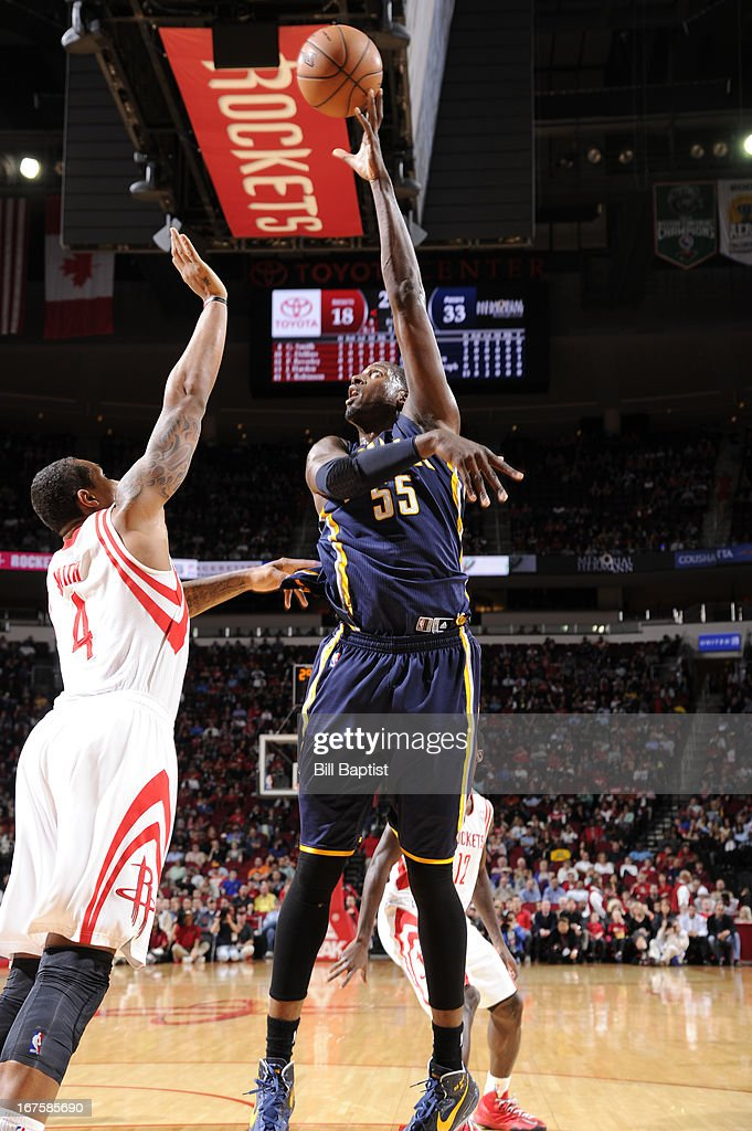 Roy Hibbert #55 of the Indiana Pacers shoots against Greg Smith #4 of the Houston Rockets on March 27, 2013 at the Toyota Center in Houston, Texas.